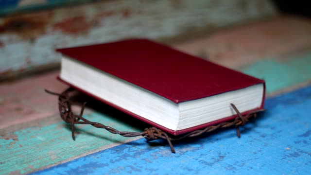 metal barbed Wire crown and the holy bible