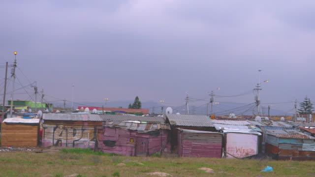 metal barracks, abandoned buildings in africa - barracks stock videos & royalty-free footage
