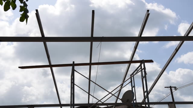 metal beam steel roof structure at house construction site, dolly shot - roof beam stock videos & royalty-free footage