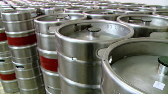 metal beer kegs stored one beside the other - keg stock videos and b-roll footage