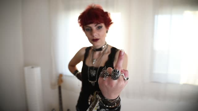 metal girl showing middle finger gesture - punk music stock videos & royalty-free footage