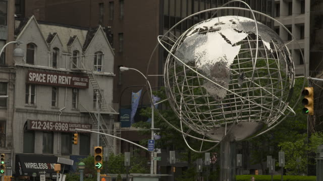 metal globe artwork outside of the trump tower and columbus circle - world politics stock videos & royalty-free footage