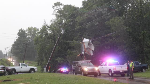 metal hanging on live power line after an ef1 tornado with 130 mph winds made an 822 mile path saturday june 15 2019 near ellettsville ind the... - power line stock videos & royalty-free footage