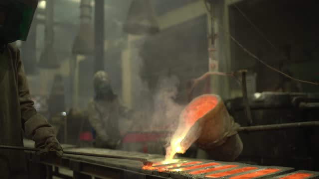 metal industry work - pouring molten metal - metal industry stock videos & royalty-free footage