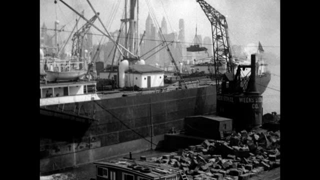metal junk barge ws crane on dock lifting metal scraps onto ship ws 'rendino' junk man w/ three young men unloading bags of metal cu 'rendino' going... - junk ship stock videos & royalty-free footage