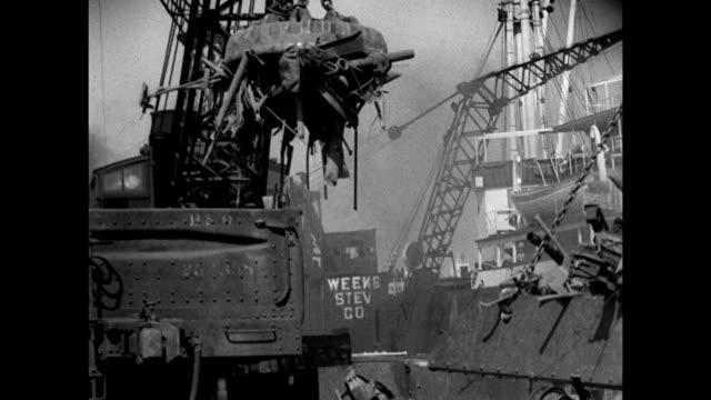 metal junk yard by harbor ship loading bg ws magnetic crane dropping metal scraps into cargo hold ws italian flag on ship ws crane lifting junk dock... - junk ship stock videos & royalty-free footage