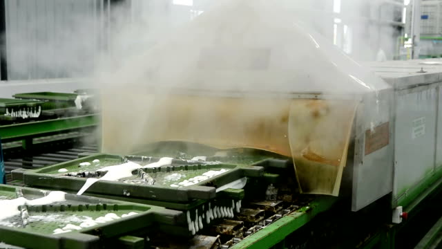 metal latex pillow mold moving out of machine on conveyor belt - latex stock videos & royalty-free footage