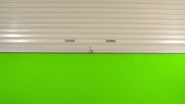 metal roll shutter door move up with green screen chroma key - metal stock videos & royalty-free footage