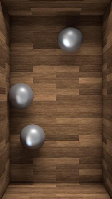 metallkugeln, die sich in einer holzkiste bewegen und auf die kräfte der schwerkraft reagieren - schwerkraft stock-videos und b-roll-filmmaterial