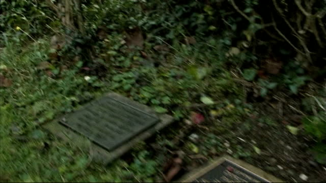 holocaust memorial plaque stolen t30111130 surrey whyteleafe shot along line of memorial plaques in churchyard bare concrete base where plaque... - memorial plaque stock videos and b-roll footage