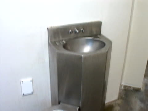 vídeos de stock, filmes e b-roll de metal toilet in empty prison cell at guantanamo bay detention center/ guantanamo province cuba - household fixture