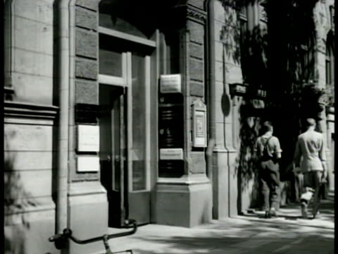 metal work union building entrance int ws swedish clerks at pay window ms man on line at window receiving pay payday pay check labor - 1949 stock videos & royalty-free footage