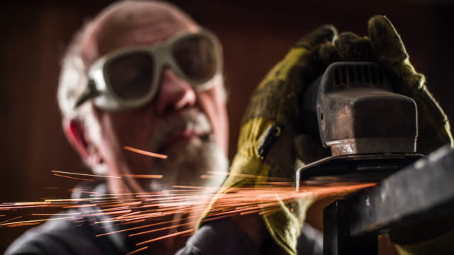 metal worker using a grinder - slow motion - metalwork stock videos and b-roll footage