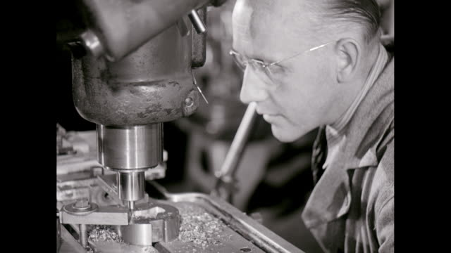 cu metal worker using drill in factory / united states - metal industry stock videos and b-roll footage
