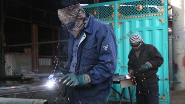 metal workers weld gates for homes and compounds at a workshop in kabul afghanistan monday november 18 2017 photographer victor blue shots shot of... - compounding stock videos and b-roll footage