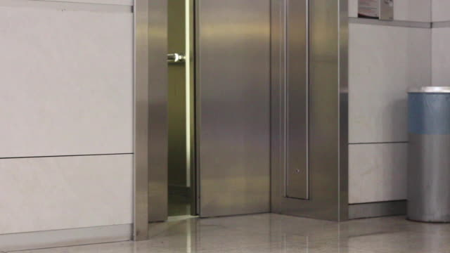 metallic colored elevator door slides to close - lobby stock videos & royalty-free footage