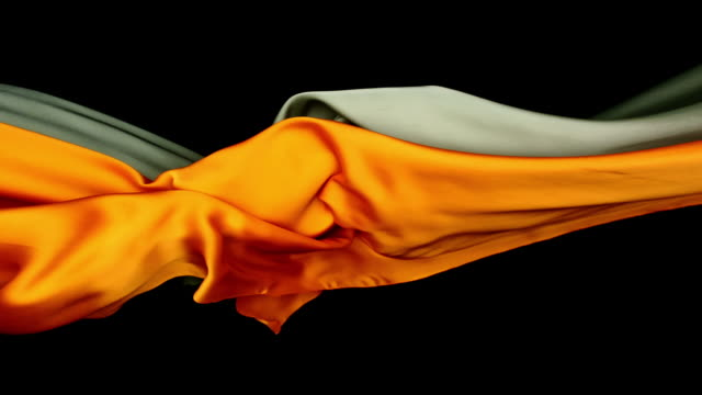 metallic silver and orange silky fabrics flowing and waving horizontally in super slow motion and close up, black background - modern stock videos & royalty-free footage