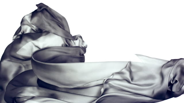 vidéos et rushes de metallic silver silky fabric flowing and waving horizontally in super slow motion and close up, white background - gris