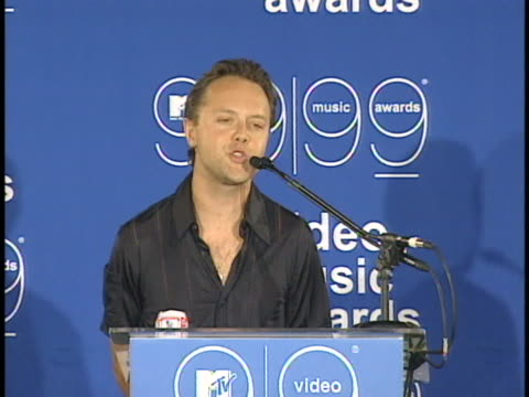 metallica band member lars ulrich speaks at a press conference backstage at the mtv video music awards. - メタリカ点の映像素材/bロール