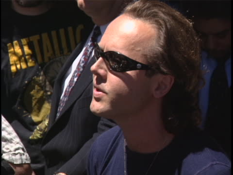 metallica drummer lars ulrich issues statement on napster during press conference. - メタリカ点の映像素材/bロール