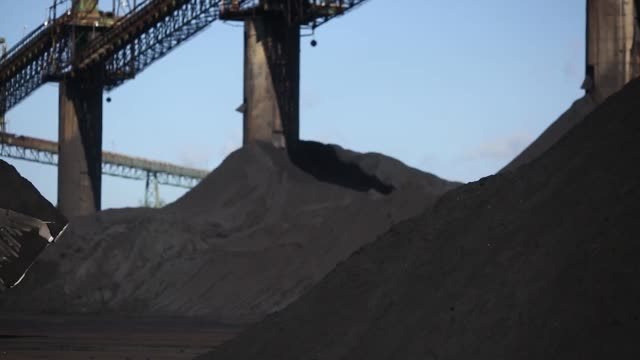 Metallurgical coal is pictured being moved around with excavators at the SunCoke Energy Inc Ceredo Coal Terminal in Ceredo West Virginia US on...