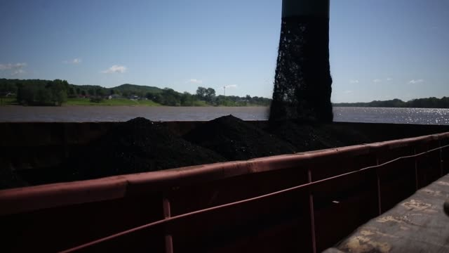Metallurgical coal is pictured transported via water at the SunCoke Energy Inc Ceredo Coal Terminal in Ceredo West Virginia US on Tuesday May 2 2017...