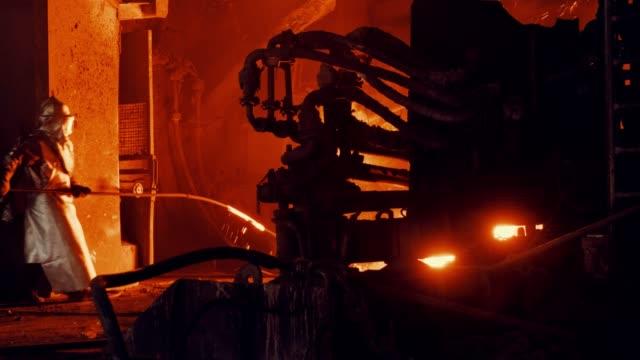 metallurgical plant - steel furnace worker takes a sample of metal - steel mill stock videos & royalty-free footage