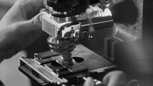 stockvideo's en b-roll-footage met 1940 montage metallurgists and other scientists in laboratories and research facilities maintaining quality control for wartime industrial production / united kingdom - 1940