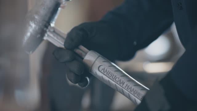 slo mo cu metalsmith examines steel manufactured hammer - handle stock videos & royalty-free footage