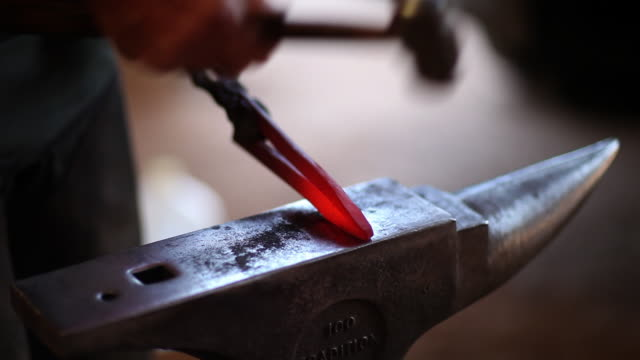 MS Metalsmith hammering hot metal / Santa Fe, New Mexico, United States