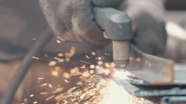 metalsmith welding in workshop - passion stock videos & royalty-free footage