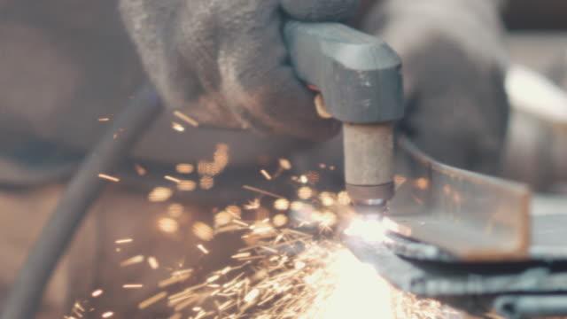 Metalsmith welding in workshop