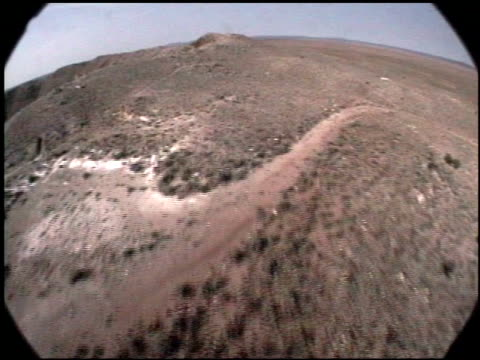 meteor crater plunges into an otherwise level arizona desert. - meteor crater stock videos & royalty-free footage