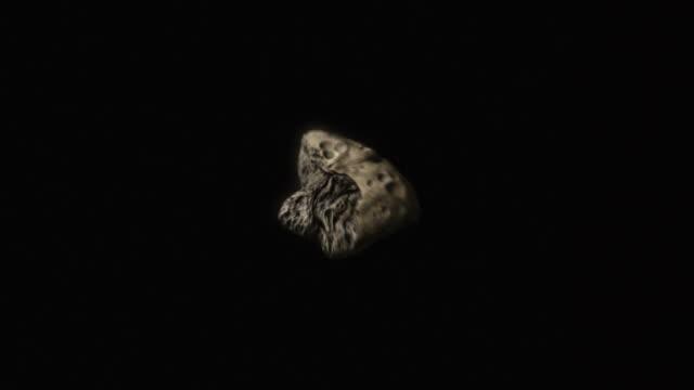 a meteor flies past the moon. - 小惑星点の映像素材/bロール