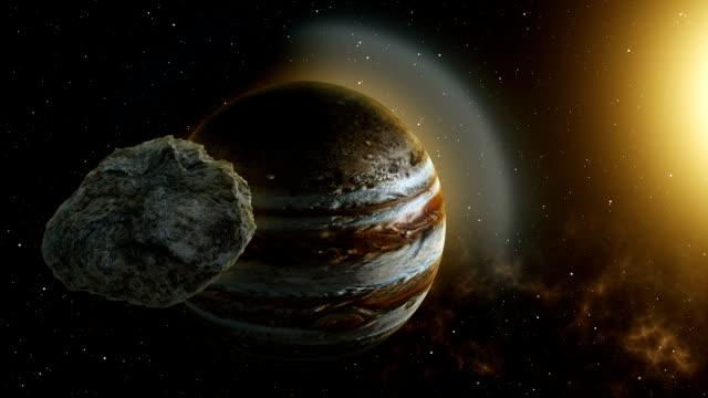 vídeos de stock e filmes b-roll de meteor flies to jupiter - júpiter