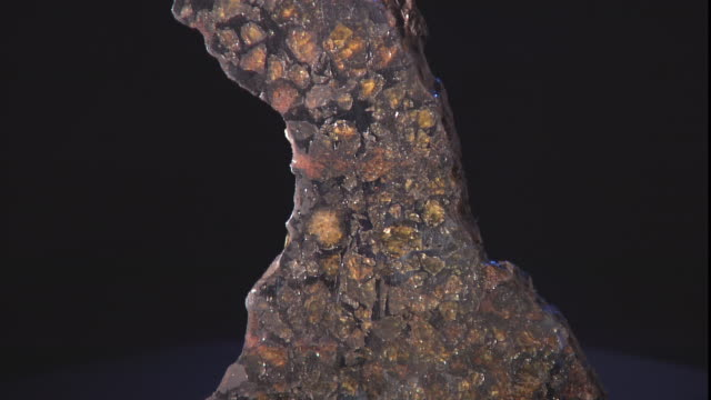 a meteorite is on display against a black background. - payson stock videos & royalty-free footage