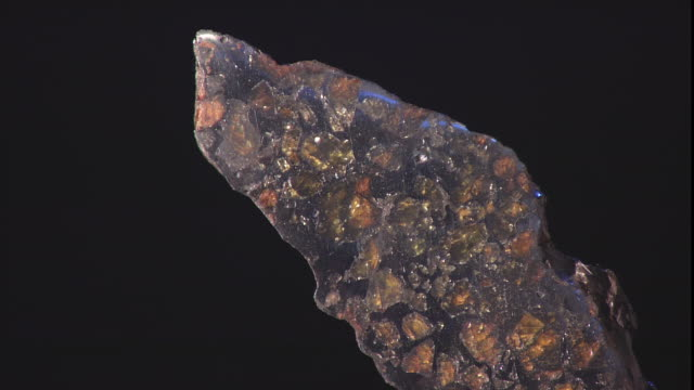 a meteorite reflects light as it turns. - payson stock videos & royalty-free footage