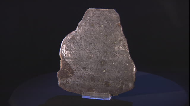 a meteorite rests on a display table. - payson stock videos & royalty-free footage