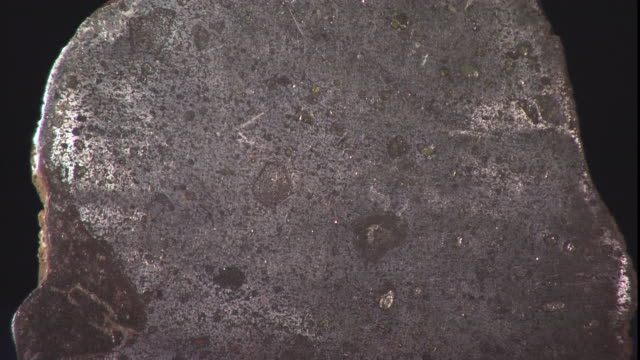 a meteorite rests on a table. - payson stock videos & royalty-free footage