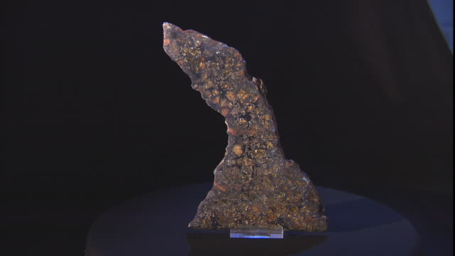 a meteorite rests on a turntable. - payson stock videos & royalty-free footage
