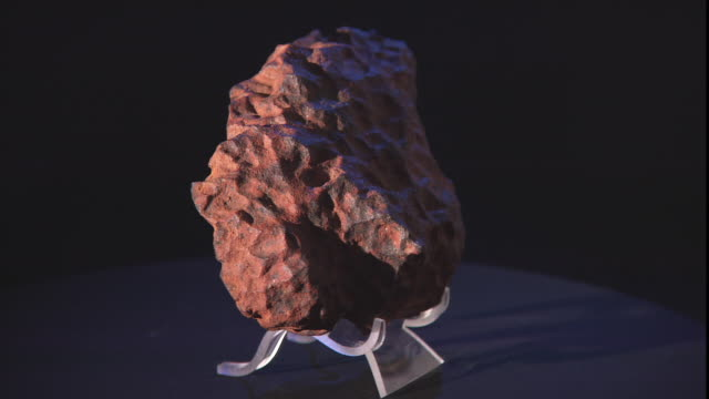 a meteorite rotates on a turntable. - payson stock videos & royalty-free footage