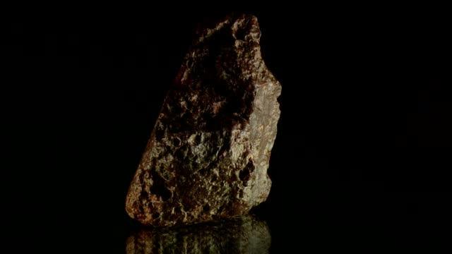 meteorite rotating on black - rock object stock videos and b-roll footage