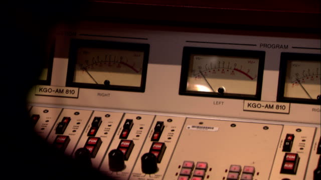 a meter moves on a piece of equipment at a radio station. - radio stock-videos und b-roll-filmmaterial