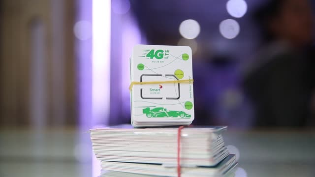 Metfone sim cards stand on display above a counter at a smartphone store in Phnom Penh Cambodia on Wednesday Sept 14 Smart sim cards sit in a bundle...