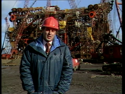 methil ship yard completes last major oil platform scotland firth of forth methil ext oil rig under construction men in cradle rig under construction... - girder stock videos & royalty-free footage