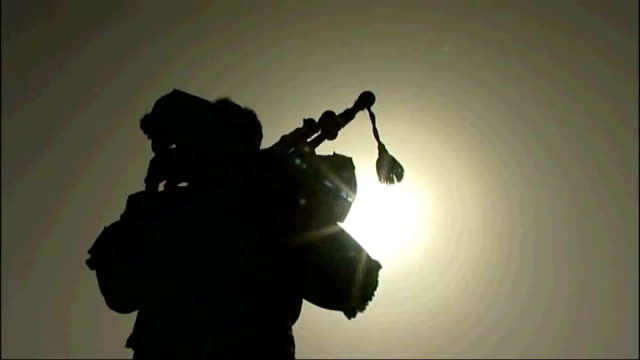 methven silhouetted against sky playing bagpipes sot members of 5 scots on look out with rifles - bagpipes stock videos & royalty-free footage