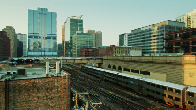 metra and l trains crossing paths at sunrise - drone shot - chicago 'l' stock videos & royalty-free footage