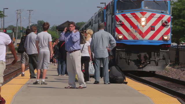 Metra train arrives at the Des Plaines Illinois station stop on the Union Pacific Northwest Line