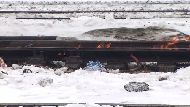 metra workers use fire to heat train tracks to cause them to work normally workers use fire to heat train tracks on january 11 2014 in chicago... - railway track stock videos & royalty-free footage