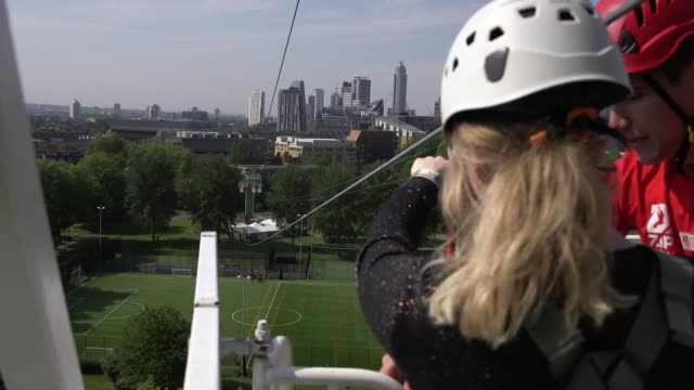 vídeos de stock, filmes e b-roll de a 225 metre zipline that allows users to soar past london's skyline has been erected in the capital the zip now london line which opens on may 22... - tirolesa